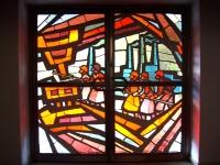 Die Tradition der Arbeiterpfarre zeigt sich am Eingangsportal
